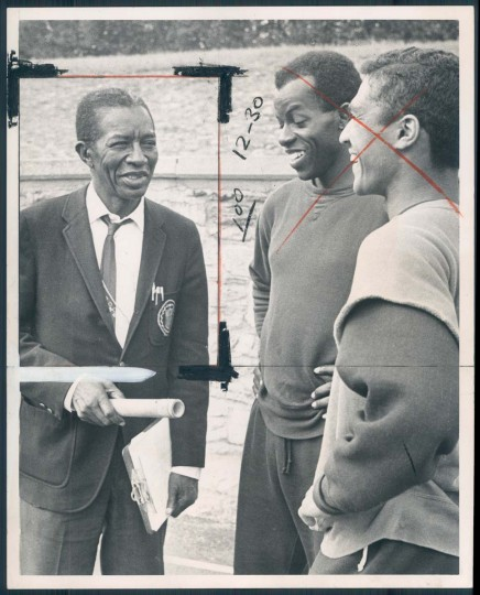 1968 caption:   Morgan State track coach ED Hurt discusses team's chances in this week's Penn Relays with Bear stars Hartley Saunders and Ronald Barbosa. Saunders is defending triple jump champ, Barbosa will run on relay. Photo by William Hotz