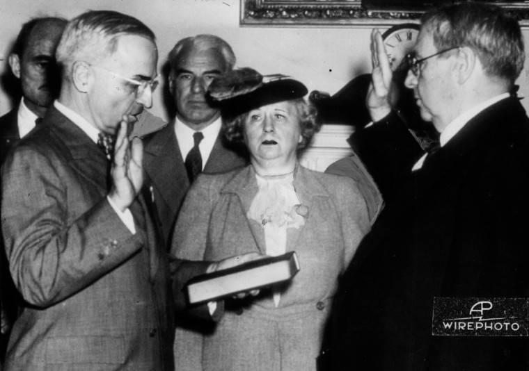 Harry S. Truman (left) is sworn in by Chief Justice Harlan Stone as President of the United States in the cabinet room of the executive offices of the White House. Mrs. Truman is at center. Attorney General Francis Biddle is just behind Truman, and between the president and Mrs. Truman is Secretary of State Edward R. Stettinius, Jr. (AP Wire Photo/Baltimore Examiner/Washington Examiner)
