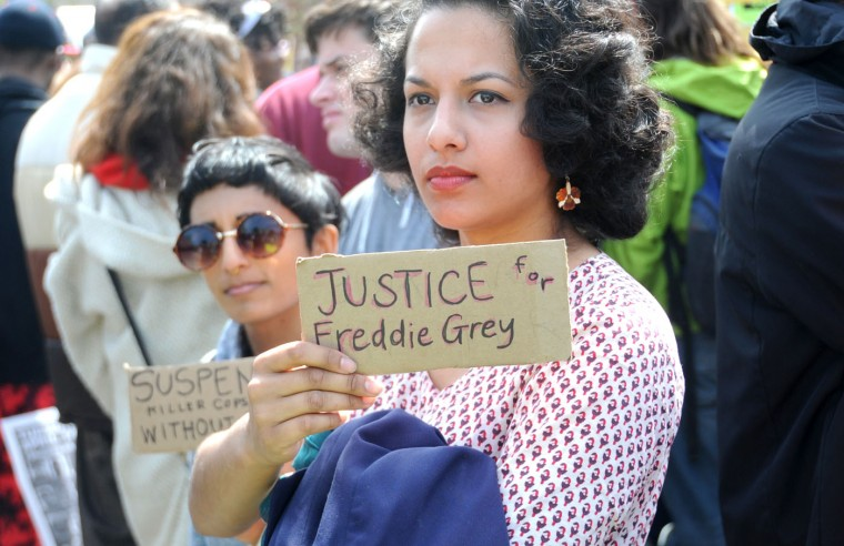 Left to right, Amy Dewan, Hampden, and Rhema Wojcik, Charles Village, attend a rally where Freddie Gray was arrested. The demonstrators then marched to City Hall to protest the death of Freddie Gray while he was in police custody. (Kim Hairston/Baltimore Sun)