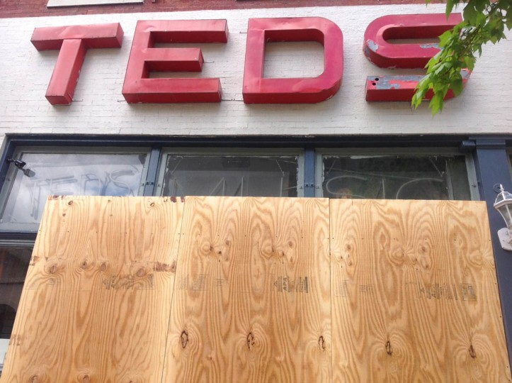 Ted's Music Store on Centre Street was damaged by rioting last night. (Jeffrey Barker/Baltimore Sun)