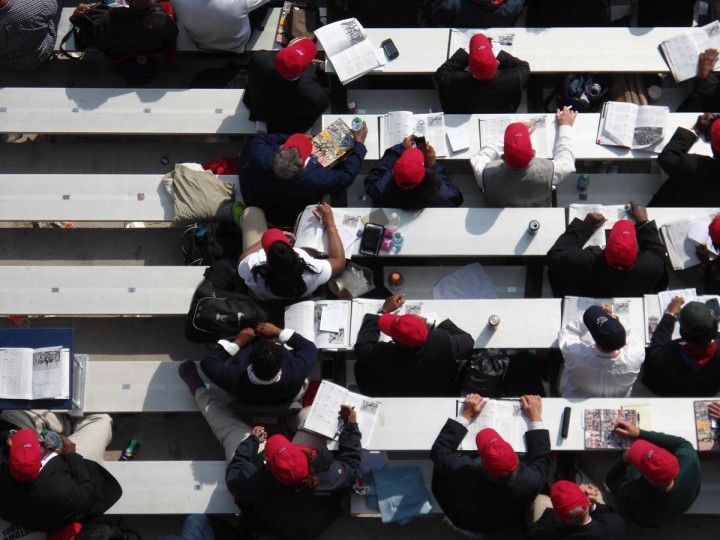 2014 caption:  Judges and meet volunteers sit in a reserved area. The University of Pennsylvania hosts the three-day meet. || Baltimore Sun file photo by Patrick Maynard