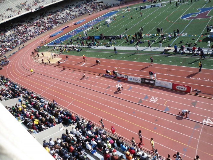 Penn Relays 2014 at Franklin Field in Philadelphia -- Runners line up for a heat of the college-level 4x400 relay. || Baltimore Sun file photo