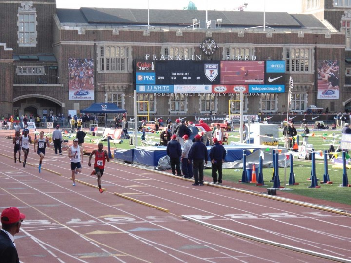 2014 caption:  Penn Relays 2014 at Franklin Field in Philadelphia -- A heat of the 4x400m relay is run on day two. The Mount Saint Mary's track team placed 2nd in the heat. || Baltimore Sun file photo by Patrick Maynard