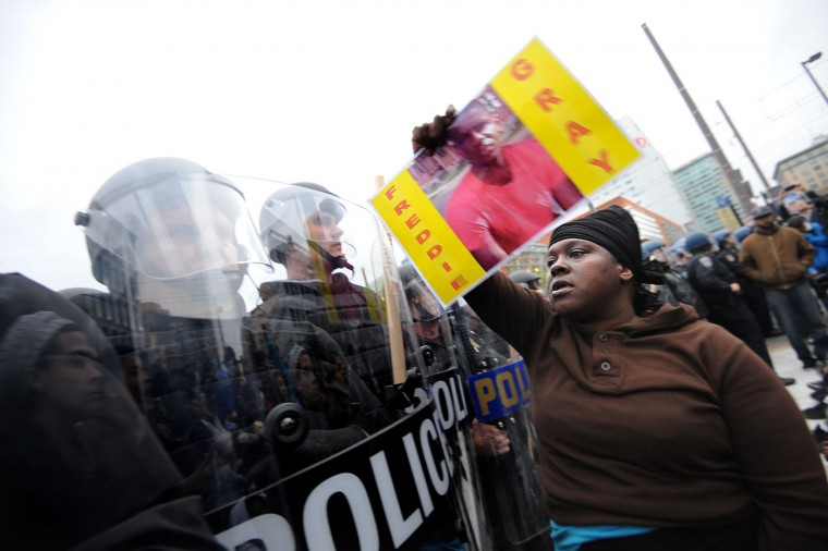 Police and protestors line up against each other across from the Sports Legends Museum as protests continue in the wake of Freddie Gray's death while in police custody. (Algerina Perna/Baltimore Sun)