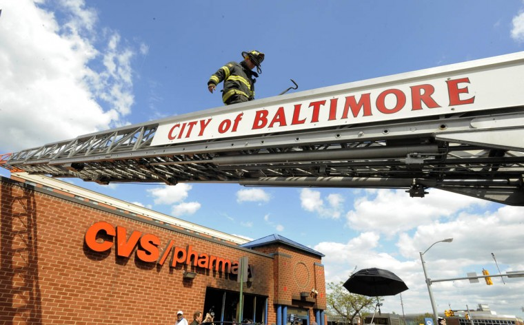 Fire trucks were called at to the CVS on North Ave. to check out a possible fire in the CVS that burned yesterday. Protesters gather at the intersection of Pennsylvania Avenue and North Avenue today a day after riots broke out in Baltimore over the death of Freddie Gray. (Lloyd Fox/Baltimore Sun)