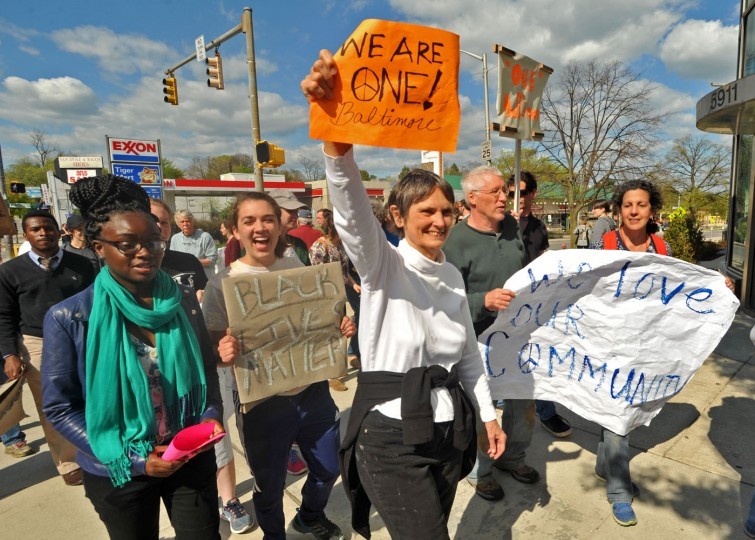 The York Road Partnership gathered members of the Govans community to rally for peace and justice on York Road between Woodbourne Avenue and East Northern Parkway. They waved signs and urged motorists to honk for peace. The rallies followed a morning cleanup by Loyola University students and others at several stores along York Road near Woodbourne Avenue that had been looted Monday night. Some stores that had been looted were closed. The riots were sparked by anger to the death of Freddie Gray, who died after sustaining injuries while in police custody. (Amy Davis/Baltimore Sun)
