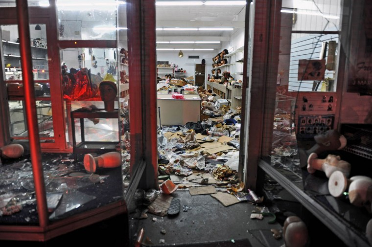 A wig store at the 2100 block of West Pratt Street is ransacked by looters as Baltimore City Firefighters battle a three-alarm fire across the street at 2111 West Pratt Street early Tuesday morning. The fire is most likely caused by wide spread unrest and looting resulting from the Freddie Gray protest. (Kenneth K. Lam/Baltimore Sun)