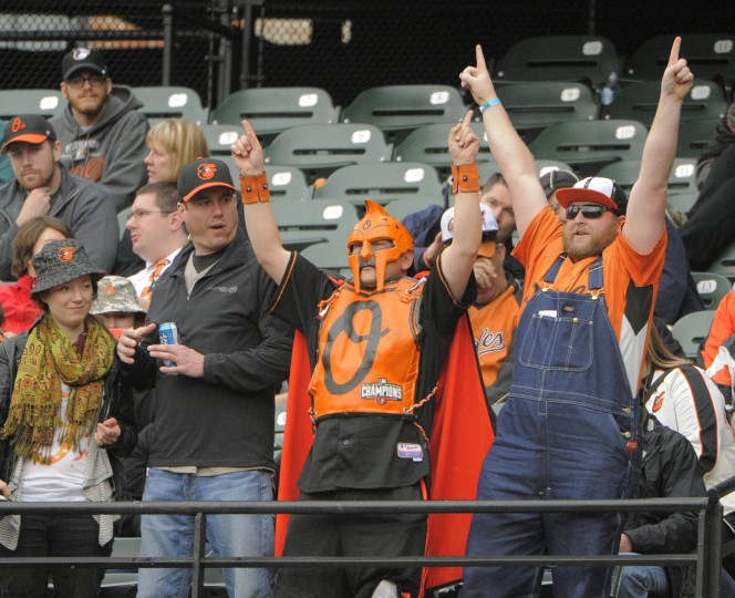 Baltimore Orioles fans try to rally the team against the Toronto Blue Jays in the ninth inning during the Orioles' home opener. (Karl Merton Ferron/Baltimore Sun)