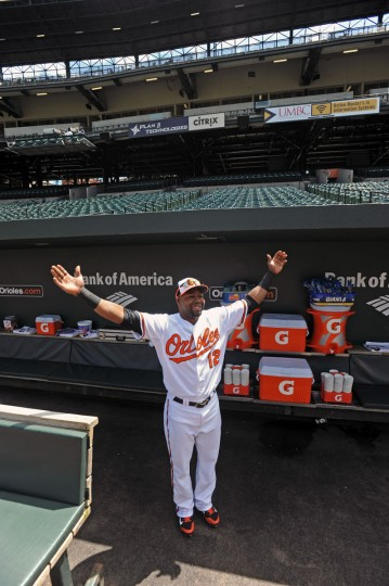 Orioles' Alejandro De Aza gestures toward thew White Sox dugout before start of today's game. The Orioles plays the Chicago White Sox to an empty Oriole Park at Camden Yards on Wednesday. The first two games of the series were cancelled due to the wide spread riots and looting on Monday in Baltimore resulting from protest over the death of Freddie Gray. (Kenneth K. Lam/Baltimore Sun)