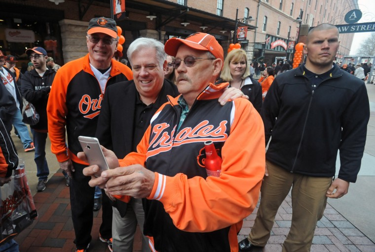 Jimmy Lawson, right, of Bel Air, gets a selfie with Gov. Larry Hogan on Eutaw Street at Orioles Park. (Kenneth K. Lam/Baltimore Sun)