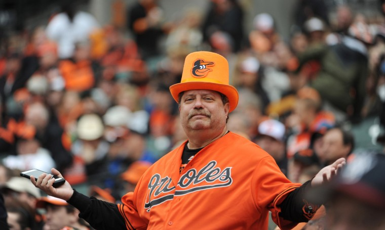 David Needle, of Anaheim, Ca., reacts after Chris Davis' long fly ball to left, field was caught for an out in the sixth inning. The Baltimore Orioles is defeated by Toronto Blue Jays by score of 12 to 5 in the 2015 season home opening day at Oriole Park at Camden Yards. (Kenneth K. Lam/Baltimore Sun)