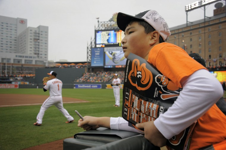 Grant DeVivo, a 13-year old from Westminster, looks to get autographs as the Orioles warm up before the opening day game against the Blue Jays. (Karl Merton Ferron/Baltimore Sun)