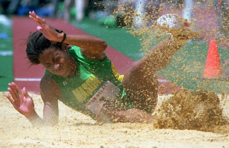 1995 caption:  Diane Guthrie-Gresham  of George Mason lands in the sand during Women's College long jump championship at the Penn Relays Thursday, April 27,1995, in Philadelphia. Guthrie-Gresham, who won the heptathlon on Wednesday, won the long jump championship. || CREDIT: RUSTY KENNEDY - AP PHOTO