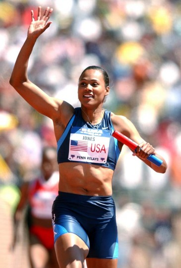 2004 caption:  Olympian Marion Jones waves after anchoring the Olympic development 400-meter relay at the Penn Relays on Saturday, April 24, 2004, in Philadelphia. Jones, Angela Daigle, Chryste Gaines and Inger Miller won the race with a time of 42.63 seconds.  || CREDIT: CHRIS GARDNER - AP PHOTO