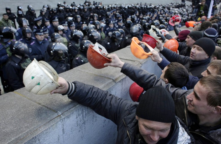 "Ukrainian coal miners protest outside the Government building in Kiev demanding the government protect their jobs as the eastern separatist conflict threatens to force pits to close. Banging their helmets, the miners yelled ""Shame"" on the pro-western government, demanding it raise their pay and restore subsidies to the mines that help power the Ukrainian industry. (Anatolii Stepanov/AFP/Getty Images)"