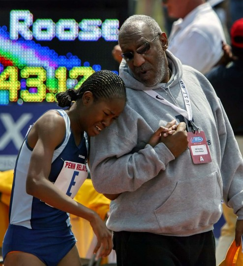 2008 caption:  Tasha Stanley, from Eleanor Roosevelt high school, is comforted by actor and comedian Bill Cosby after she competed in the high school girl's 4x800 championship at the Penn Relays in Philadelphia, Friday, April 25, 2008.  || CREDIT: JOSEPH KACZMAREK - AP PHOTO