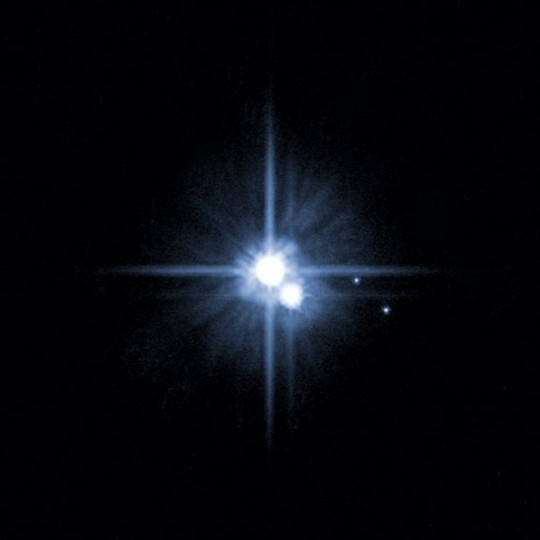 This Hubble Space Telescope image shows two new moons around Pluto. (AP Photo/NASA)