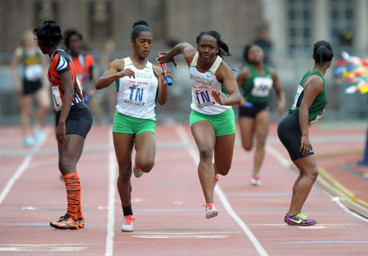 2012 caption:  Diamond Thomas takes the handoff from Traci Hicks on the third leg of the Long Beach Poly girls 4 x 100m relay that had the top time of 46.39 in the 118th Penn Relays at Franklin Field.  Credit: Kirby Lee - Image of Sport - US PRESSWIRE