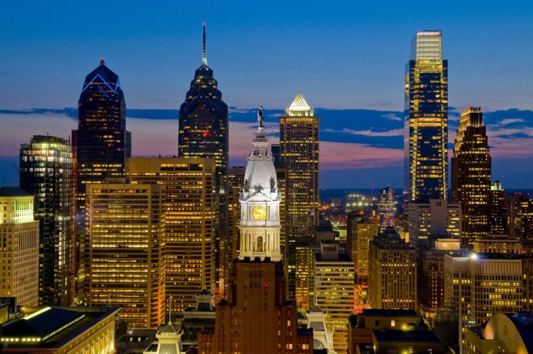 A downtown skyline view of Philadelphia, the annual host of the event.  2008 caption:  A dramatic evening sky view of Philadelphia highlights the contrast of new and old living side by side. In the center of the shot stands the bronze statue of the city's founder, William Penn, sitting on top of the 511-foot City Hall Tower with its lighted clock. And the newest addition to the skyline, the Comcast Center on the right towers as the tallest building between New York and Chicago.   ..OUTSIDE TRIBUNE CO.- NO MAGS,  NO SALES, NO INTERNET, NO TV, NEW YORK TIMES OUT, CHICAGO OUT, NO DIGITAL MANIPULATION... ORG XMIT: CHI1006251651172771