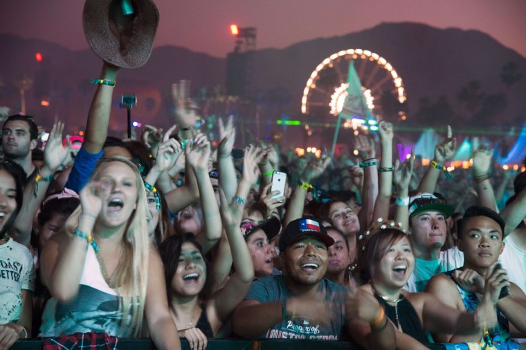 Festival-goers react as US DJ Kaskade performs on day three of the Coachella Music Festival in Indio, California, April 12, 2015. (ROBYN BECK/AFP/Getty Images)