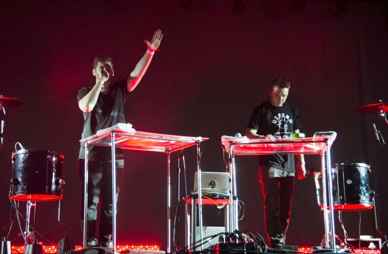 Harrison Mills and Clayton Knight of the American electronic music duo Odesza perform on day three of the Coachella Music Festival in Indio, California, on April 12, 2015. (ROBYN BECK/AFP/Getty Images)