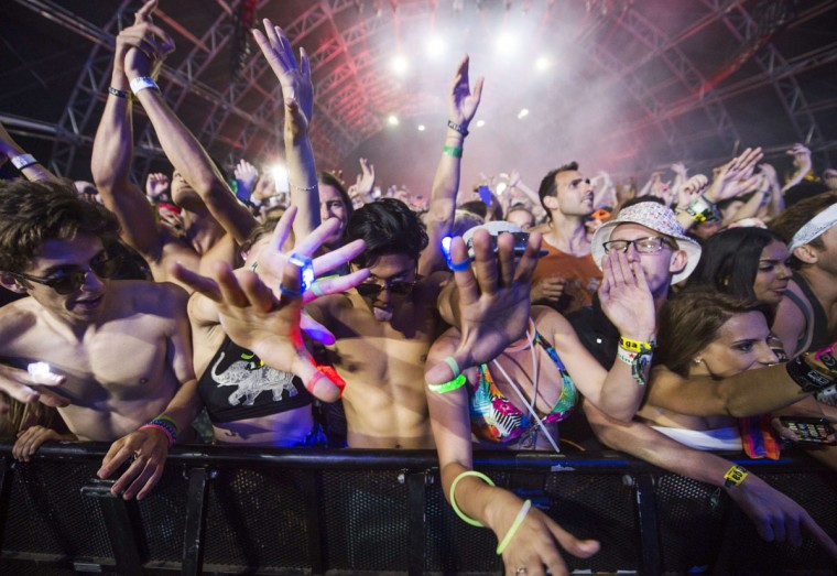 Festival-goers watch as David Guetta performs on day three of the Coachella Music Festival in Indio, California, April 12, 2015. (ROBYN BECK/AFP/Getty Images)