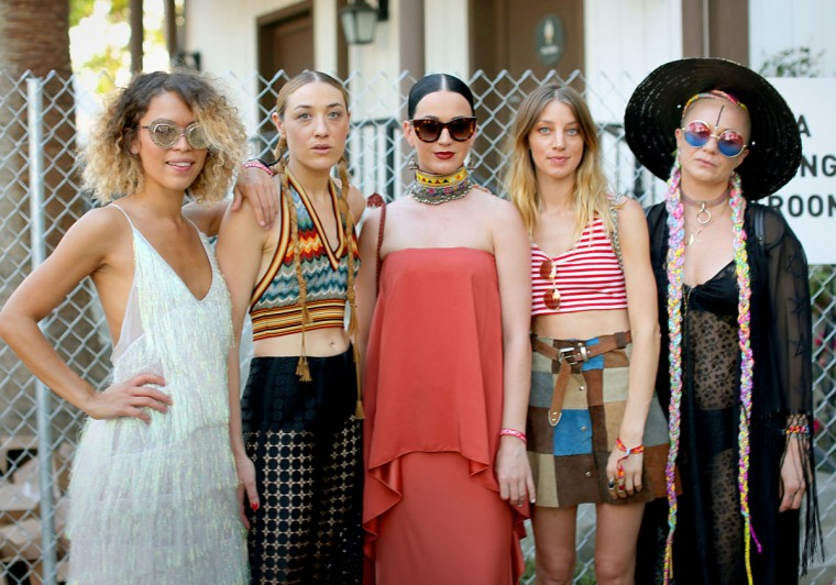 Mia Moretti (2nd from left) and Katy Perry (center) with guests in the VIP arena during the 2015 Coachella Valley Music and Arts Festival - Weekend 1 at The Empire Polo Club on April 12, 2015 in Indio, California. (Photo by Rachel Murray/Getty Images for Coachella)