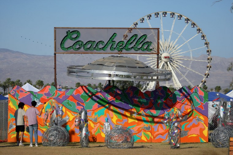 "Festival-goers view the ""Coachella Bound"" art installation at the campgrounds at The Coachella Music and Arts Festival - Weekend 2, on Sunday, April 19, 2015, in Indio, Calif. (Photo by Zach Cordner/Invision/AP)"