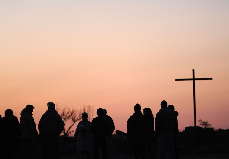 People gather at Red Bank Landing, Va. for an Easter Sunrise Service on Sunday, April 5, 2015. (AP Photo/Eastern Shore News, Jay Diem)