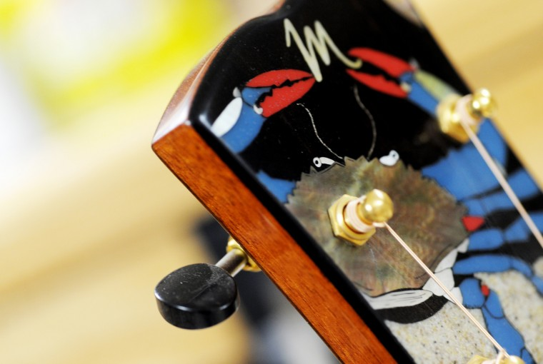 A detail shot of the head of a Maryland-themed guitar built by Cockeysville luthier David MacCubbin, with head and neck designs by Craig Lavin, of the Chesapeake Bay Guitar Project. (Jon Sham/BSMG)
