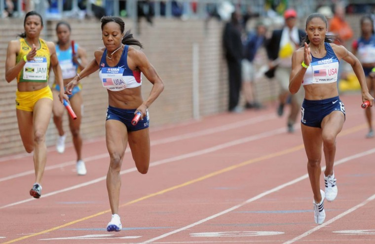 2008 caption:  Allyson Felix, right, edges out Sanya Richards, left, both of the United States, in the Olympic development women's 400 meters USA vs. the World race at the Penn Relays track and field meet in Philadelphia, Saturday, April 26, 2008.  || CREDIT: DAILY LOCAL NEWS, TOM KELLY IV - AP PHOTO