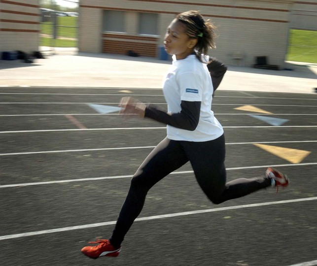 2005 caption:  COLUMBIA, MD -- Sports feature on Long Reach High School runner JaNay Woolridge, who will be competing in the up-coming Penn Relays on Thursday.  Woolridge has committed to attend University of Missouri, where she received athletic and academic scholarships.   She is pictured during practice.   BALTIMORE SUN STAFF PHOTO BY KENNETH K. LAM