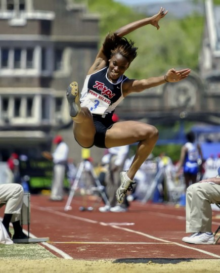 2006 caption:  Maryland's Kierra Foster, who placed first, competes in the college women's long jump championship during the 112th Penn Relays, Thursday, April 27, 2006, in Philadelphia. She is part of 20,000 athletes participating in the Penn Relays, which began Thursday at Franklin Field. Every April, the Ivy League school's quiet campus hosts small colleges, NCAA champions and Olympians for three days in the sport's oldest relay event.  || CREDIT: H. RUMPH JR. - AP PHOTO