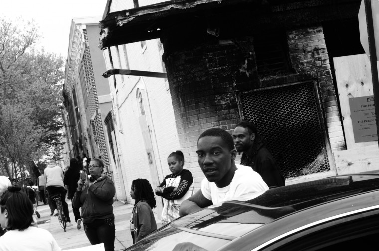 May 1: A massive march from City Hall to the Glimor Homes neighborhood remains peaceful. Residents stop for the procession in front of a burned-out market a block from where Freddie Gray was arrested.