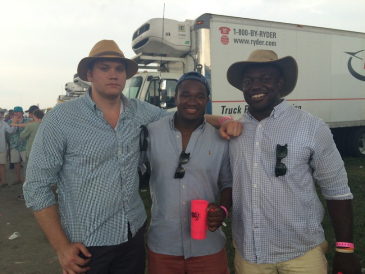 "From left, Josh Haywood, 23, of Columbus; Brandon Pinnock, 23, of Baltimore; and Tate Steinhilber, 26, of Pittsburgh. Like many others today, they came to Preakness because ""It's a bucket list kind of event,"" Steinhilber said. They aren't fans of Armin van Buuren, but came for the experience, not a specific act. ""I'm pretty sure we would have come no matter who was playing,"" Pinnock said. They said Preakness' timing is likely what saved it from being affected by unrest in Baltimore. They agreed if the six officers involved in the Freddie Gray case hadn't been charged, or if a development had occurred in the last few days, things might have been different. ""If it had been a week earlier maybe, but this is kind of a different crowd,"" Haywood said. (Quinn Kelly/Baltimore Sun)"