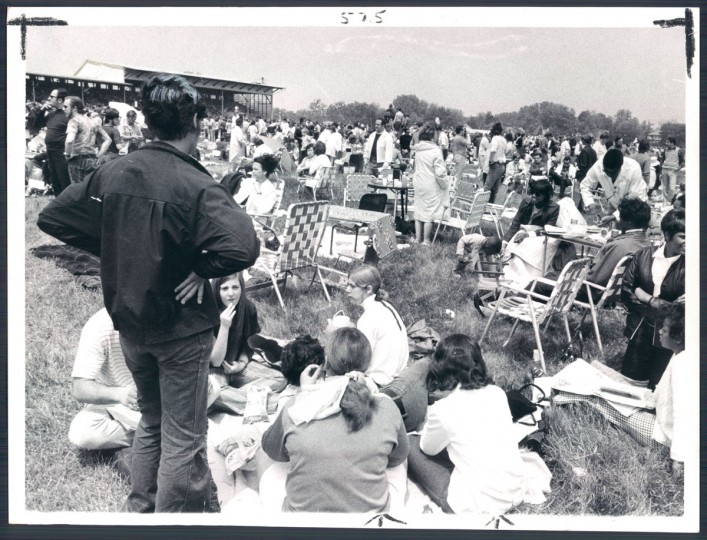 Portable chairs, blankets and food join swarms of people at Pimlico's grassy infield. (Clarence B. Garrett/Baltimore Sun, 1970)