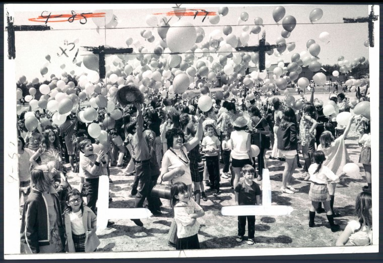 STRINGS AWEIGH - Teachers and children at Marley Elementary school release balloons in the annual Preakness Week carnival. The balloon that travels the farthest wins a prize for the buyer and the seller. (William Hotz/Baltimore Sun, 1971)