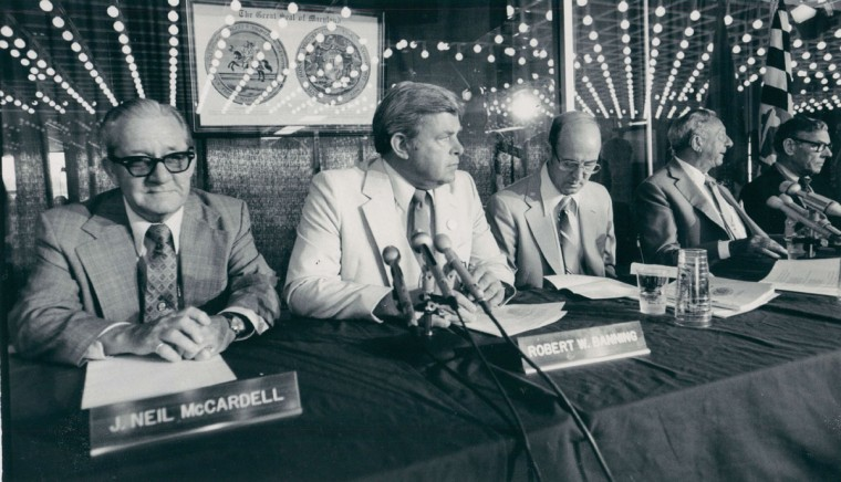 Assistant attorney general Frank Paugh (center) is flanked by Maryland State Racing Commission members (from left) J. Neil McCardell, Robert W. Banning, Frank W. Cuccia and Kenneth C. Proctor at the hearing at Pimlico. (Walter M. McCardell/Baltimore Sun, 1980)