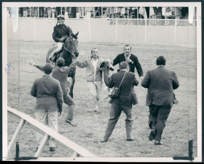 HERO'S WELCOME - Canonero II gets a big greeting coming back up track and on the way to the Pimlico winner's circle. (Clarence B. Garrett/Baltimore Sun, 1971)