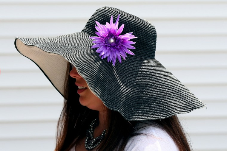 A woman wearing a festive hat looks on prior to the 141st running of the Kentucky Derby at Churchill Downs on May 2, 2015 in Louisville, Kentucky. (Elsa/Getty Images)