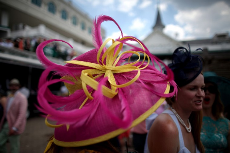 Women wearing festive hats pose in the paddock area prior to the 141st running of the Kentucky Derby at Churchill Downs on May 2, 2015 in Louisville, Kentucky. (Chris Graythen/Getty Images)
