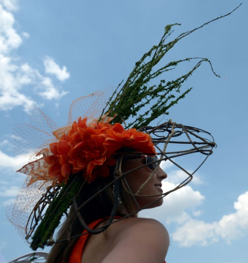 A woman wearing a festive hat looks on prior to the 141st running of the Kentucky Derby at Churchill Downs on May 2, 2015 in Louisville, Kentucky. (Dylan Buell/Getty Images)