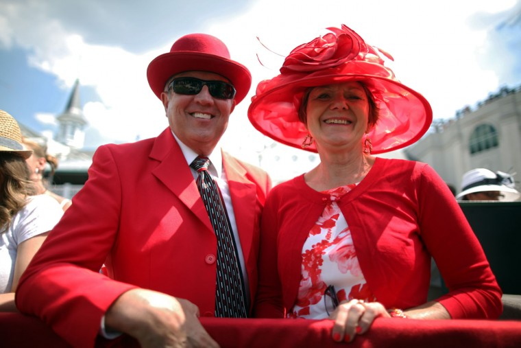 Fans wearing festive hats pose in the paddock area prior to the 141st running of the Kentucky Derby at Churchill Downs on May 2, 2015 in Louisville, Kentucky. (Chris Graythen/Getty Images)