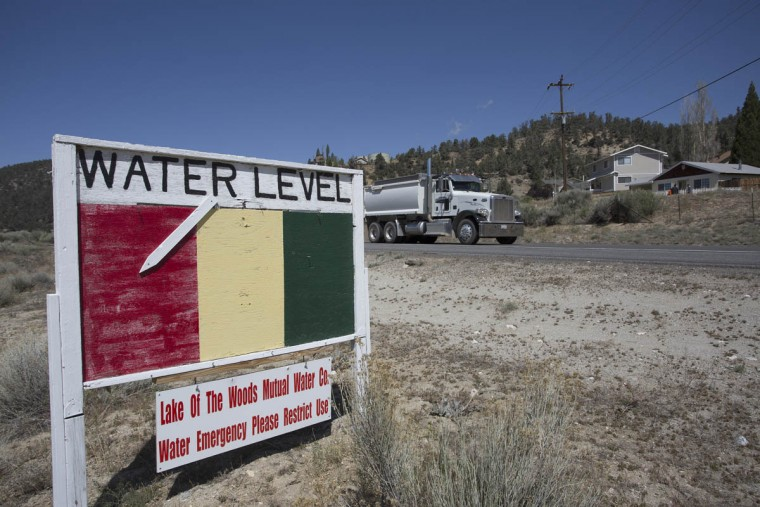 A ground water level sign emphasizes the urgency of a drought-related water supply emergency in the community of Lake of the Woods in Los Padres National Forest on May 7, 2015 near Frazier Park, California. According to an aerial survey conducted by the U.S. Forest Service in April, about 12 million trees have died in California forestlands in the past year because of extreme drought. The dead trees add to the flammability of a drying landscape that is increasingly threatened by large, intense wildfires. In some areas where extremely hot wildfires have occurred, as in the 437-square mile Cedar fire that burned across San Diego County in 2003, most trees have died and chaparral brush is displacing the forests and animals that rely upon them. The findings of the study were compared to similar surveys taken in July 2014. (David McNew/Getty Images)