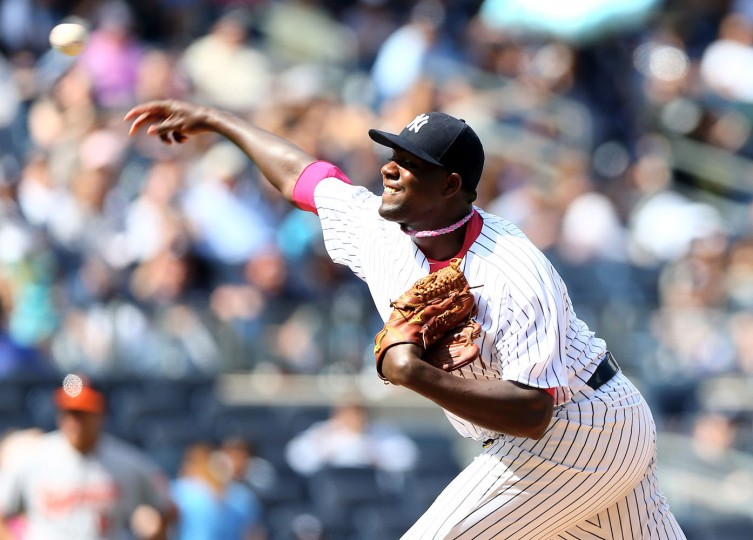 Michael Pineda #35 of the New York Yankees delivers a pitch in the seventh inning against the Baltimore Orioles on May 10, 2015 at Yankee Stadium in the Bronx borough of New York City.Members of the New York Yankees and the Baltimore Orioles wear pink today in honor of Mother's Day. (Elsa/Getty Images)