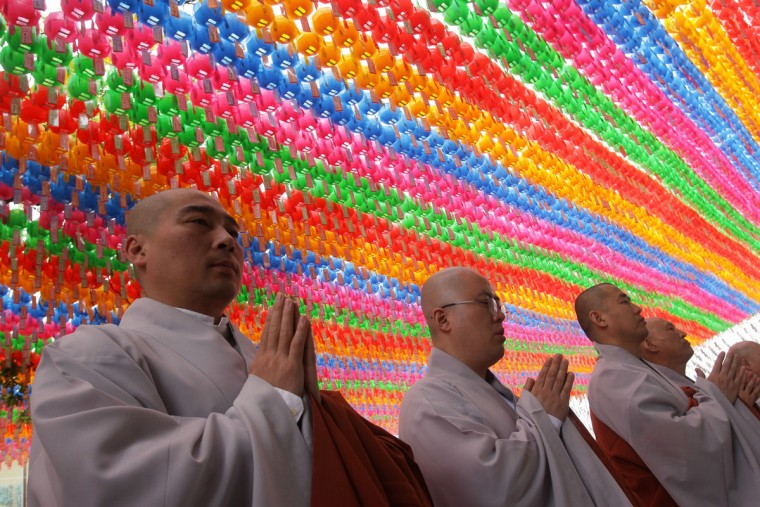 Buddhist monks pray during the 'Children Becoming Buddhist Monks' ceremony forthcoming buddha's birthday at a Chogye temple on May 11, 2015 in Seoul, South Korea. Children have their hair shaved off during the 'Children Becoming Buddhist Monks' ceremony ahead of buddha's birthday at a Chogye temple. The children will stay at the temple to learn about Buddhism for 14 days. Buddha was born approximately 2,559 years ago, and although the exact date is unknown, Buddha's official birthday is celebrated on the full moon in May in South Korea, which is on May 25 this year. (Photo by Chung Sung-Jun/Getty Images)