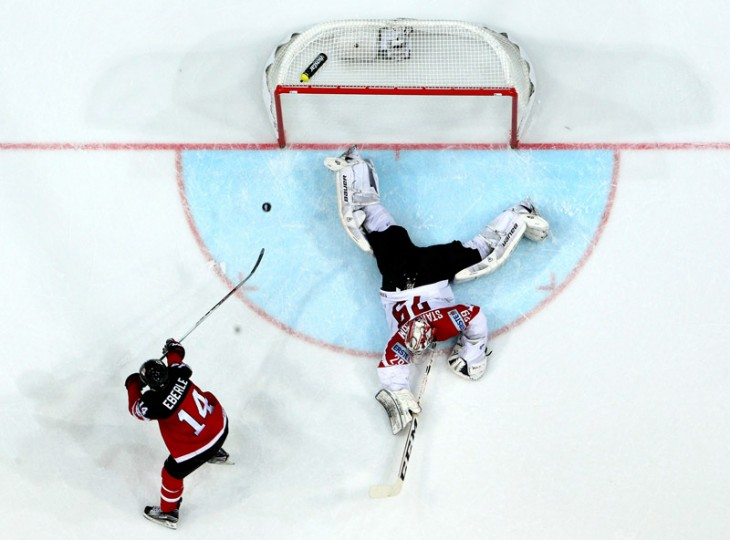 Jordan Eberle of Canada scores his team's opening goal over Bernhard Starkbaum, goaltender of Austria during the IIHF World Championship group A match between Canada and Austria at o2 Arena on Tuesday in Prague, Czech Republic. (Martin Rose/Getty Images)