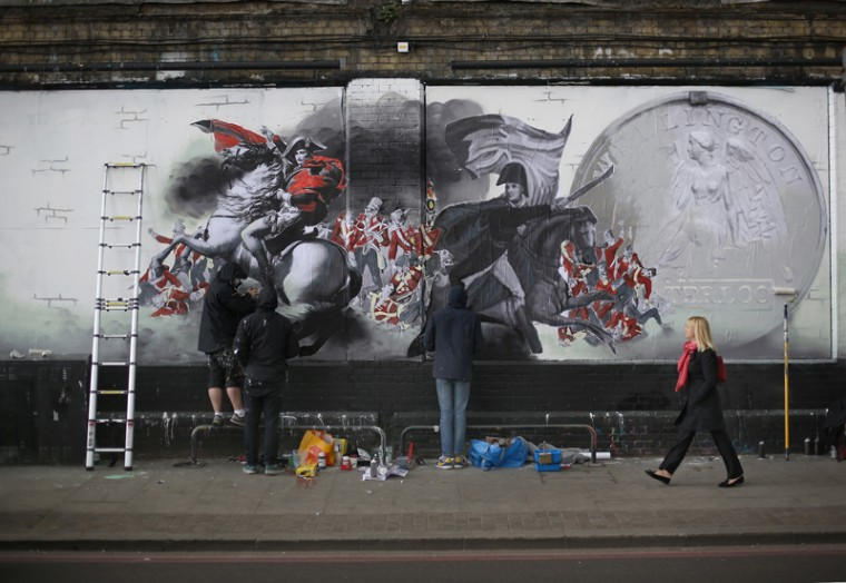 A National Army Museum commissioned mural takes shape on Tuesday in London. The 65-foot-long mural, which gives a modern take on the life of a soldier, is being painted on a wall in Shoreditch, East London. (Peter Macdiarmid/Getty Images)