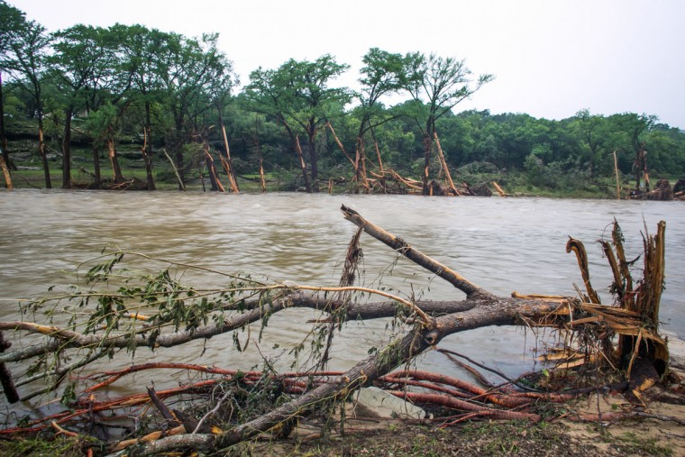 Debris is strewn up and down the Blanco River near Rio Bonito Resort May 26, 2015 in Wimberley, Texas. Central Texas has been hit with severe weather, including catastrophic flooding and tornadoes over the past several days. (Photo by Drew Anthony Smith/Getty Images)