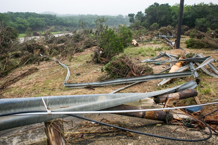 Debris is strewn along Ranch Road 12 near the Blanco River May 26, 2015 in Wimberley, Texas. Central Texas has been hit with severe weather, including catastrophic flooding and tornadoes over the past several days. (Photo by Drew Anthony Smith/Getty Images)